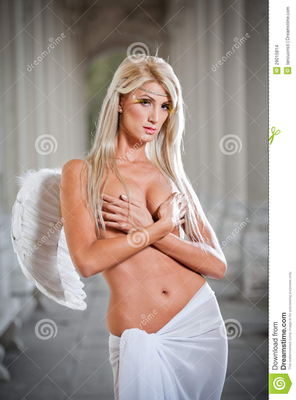 Blonde Angel With White Light Wings And White Veil Posing