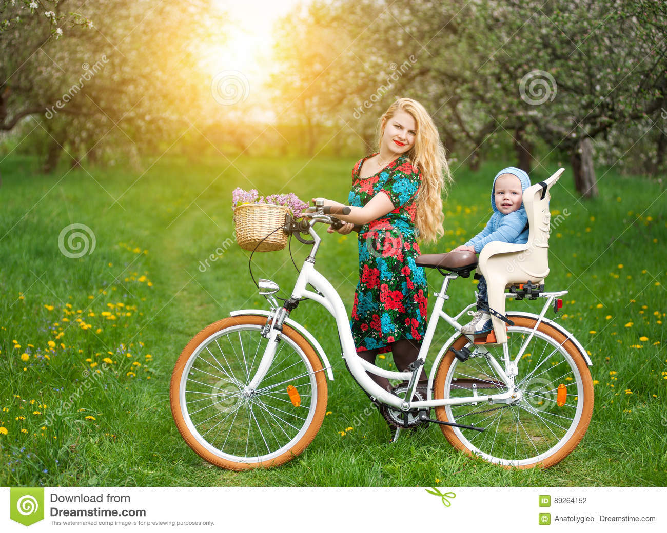 Chair Bike Blonde Female With City Bicycle With Baby In Bicycle Chair Stock
