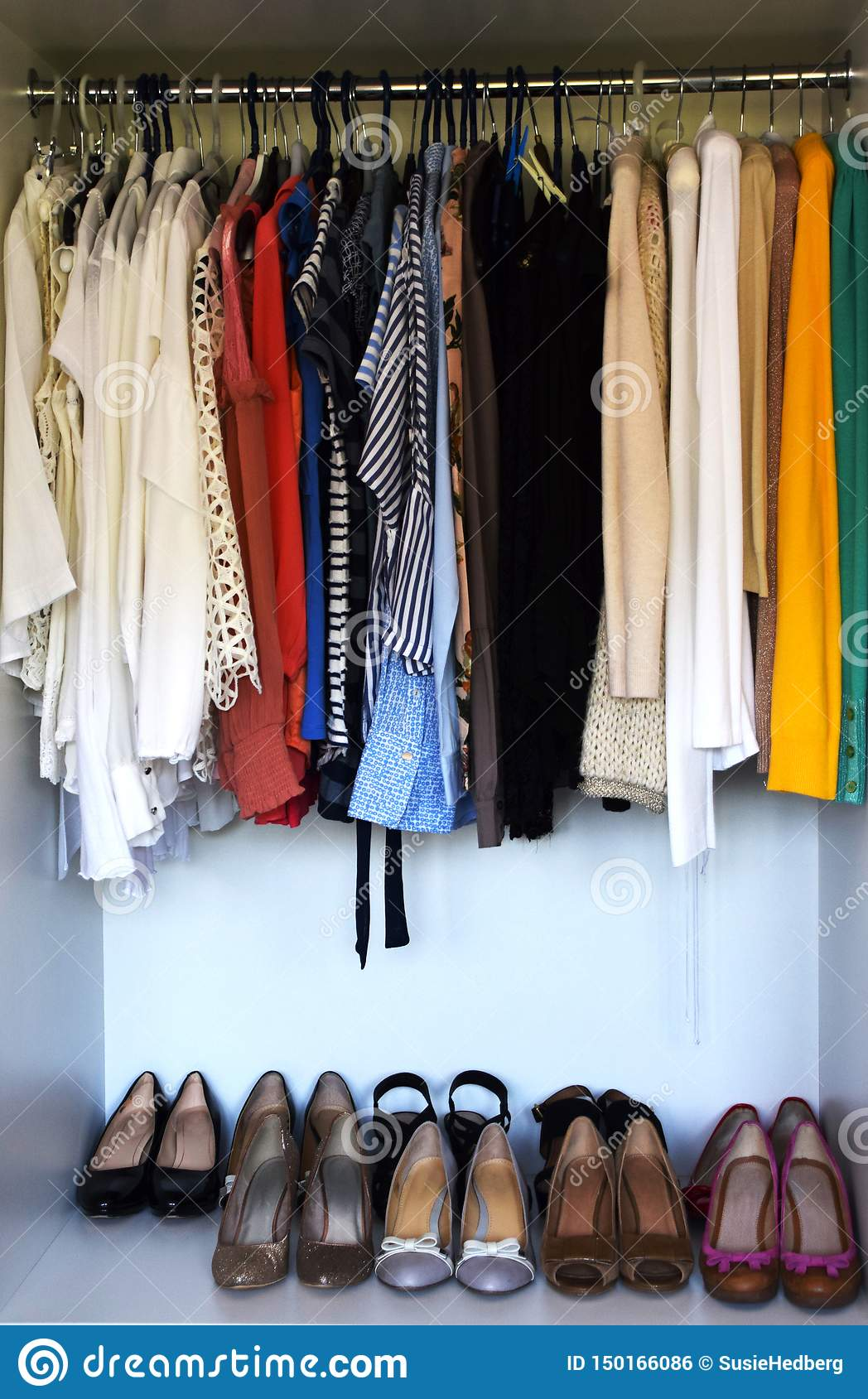 https www dreamstime com blouses shirts jumpers hanging clothes rack shoes displayed nicely wardrobe image150166086