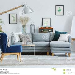 Blue Chair Living Room Framed Pictures Armchair On Grey Carpet Stock Photo Image Of Light Couch In Designer S With Lamp Easel And Sofa