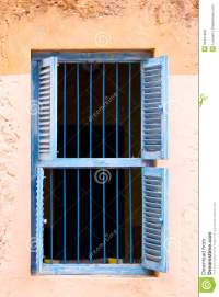 Blue Prison Bars And Wooden Louvred Shutters Royalty Free ...