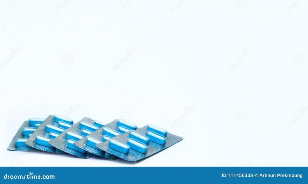 medium resolution of blue tablets pills in blister packs on white background five packs of antiviral medicine for