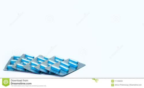 small resolution of blue tablets pills in blister packs on white background five packs of antiviral medicine for
