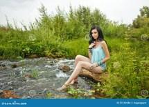Boho Girl Sitting Barefoot Beach. Stock