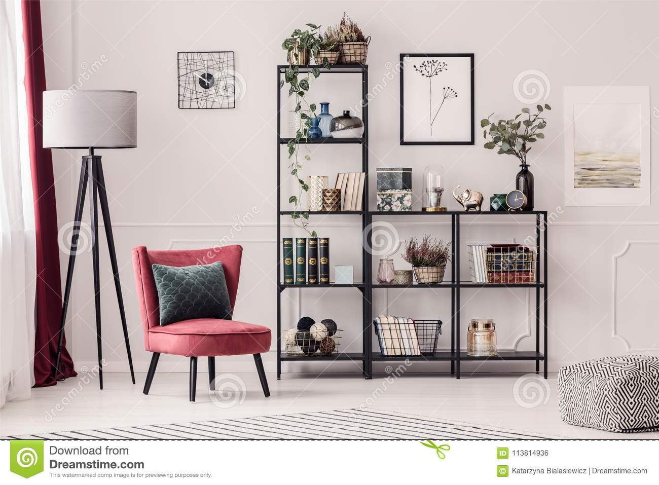 bookshelf in living room black leather furniture ideas stock photo image of rack 113814936 metal lamp and red armchair interior