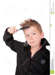 boy brushing hair. stock