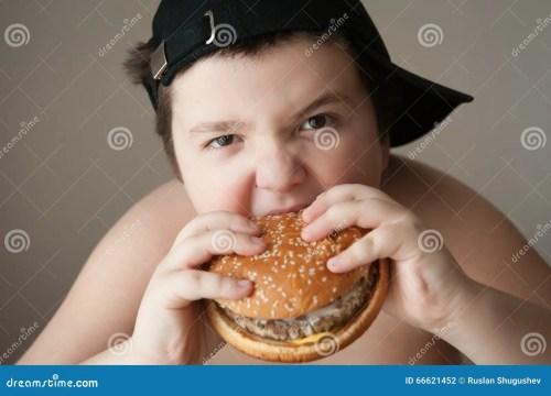 small resolution of fat boy in cap eats a hamburger