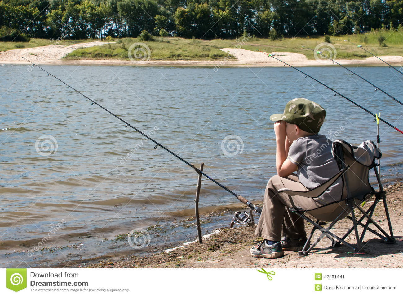 fishing rod chair contemporary accent chairs uk boy with sitting on the shore of pond