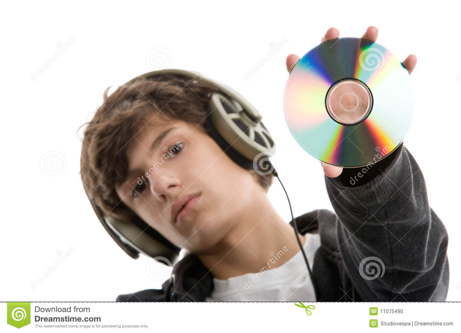 Boy Listening To Music Displaying CD Stock Photo  Image