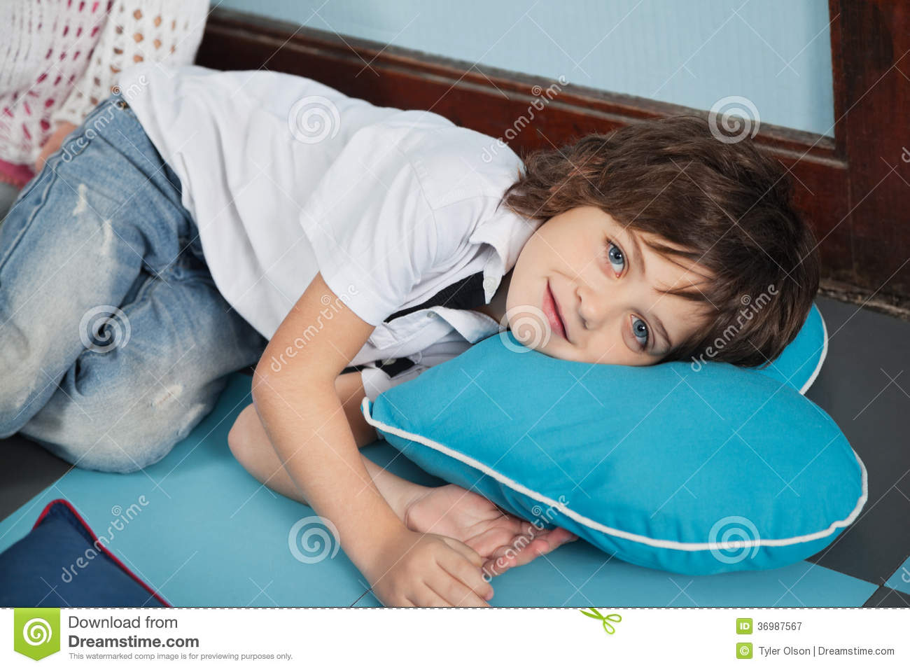 Boy Lying On Heartshaped Pillow In Royalty Free Stock