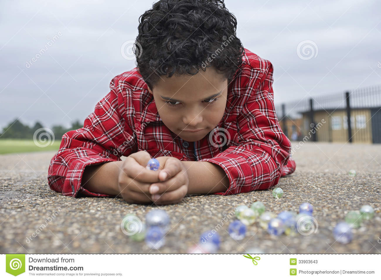 Boy Playing Marbles On Playground Stock Photos Image