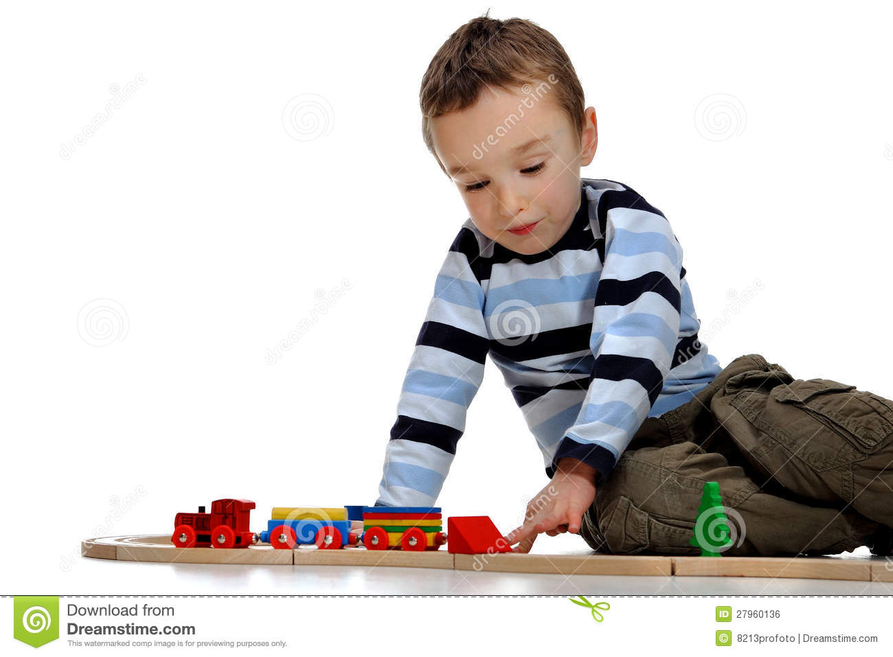 Boy Playing With A Train Set Stock Photo