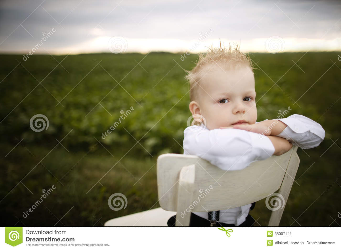 little boy chairs round chair base sits on in the field stock image 35007141