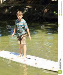 Boy Standing Surf Stock - 57411950