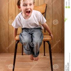 Stool Chair Photography Pottery Barn Charleston 1 2 Slipcover Boy Throwing A Tantrum While On Time Out Stock Photo - Image: 7442552