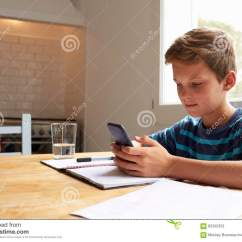 Kitchen Phone Sink Oakley Boy Uses Mobile Whilst Doing Homework At Table Stock
