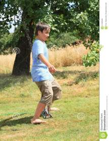 Boy Walking Sprinkler Stock - 57420844