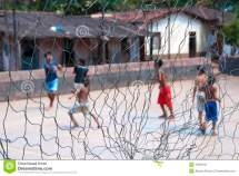 Barefoot Boys Playing Soccer