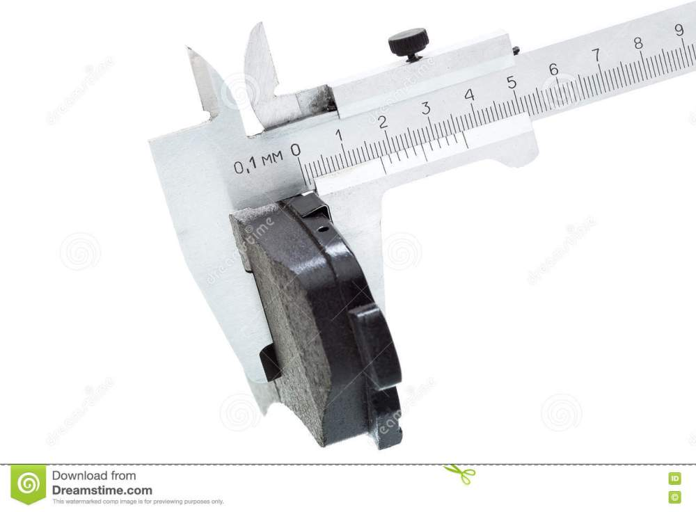 medium resolution of brake pads of the car on a white background measurement by a caliper of thickness isolated image nobody