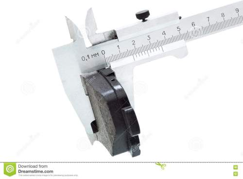 small resolution of brake pads of the car on a white background measurement by a caliper of thickness isolated image nobody
