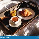 Breakfast In Bed Wooden Bed Tray With Coffee Croissant Jam Early Morning Sunlight Stock Photo Image Of Interior Comfortable 175898502