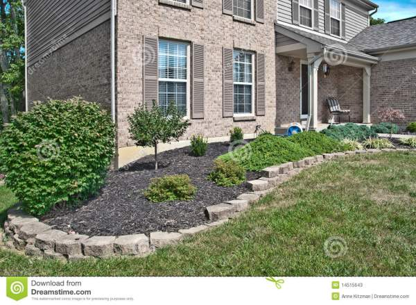 brick home landscaping beds stock