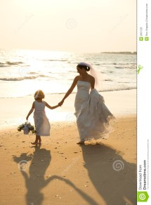 Bride And Flower Girl Walking Royalty Free Stock
