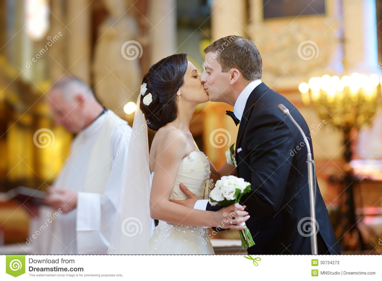 Bride And Groom Kissing In A Church Stock Image  Image