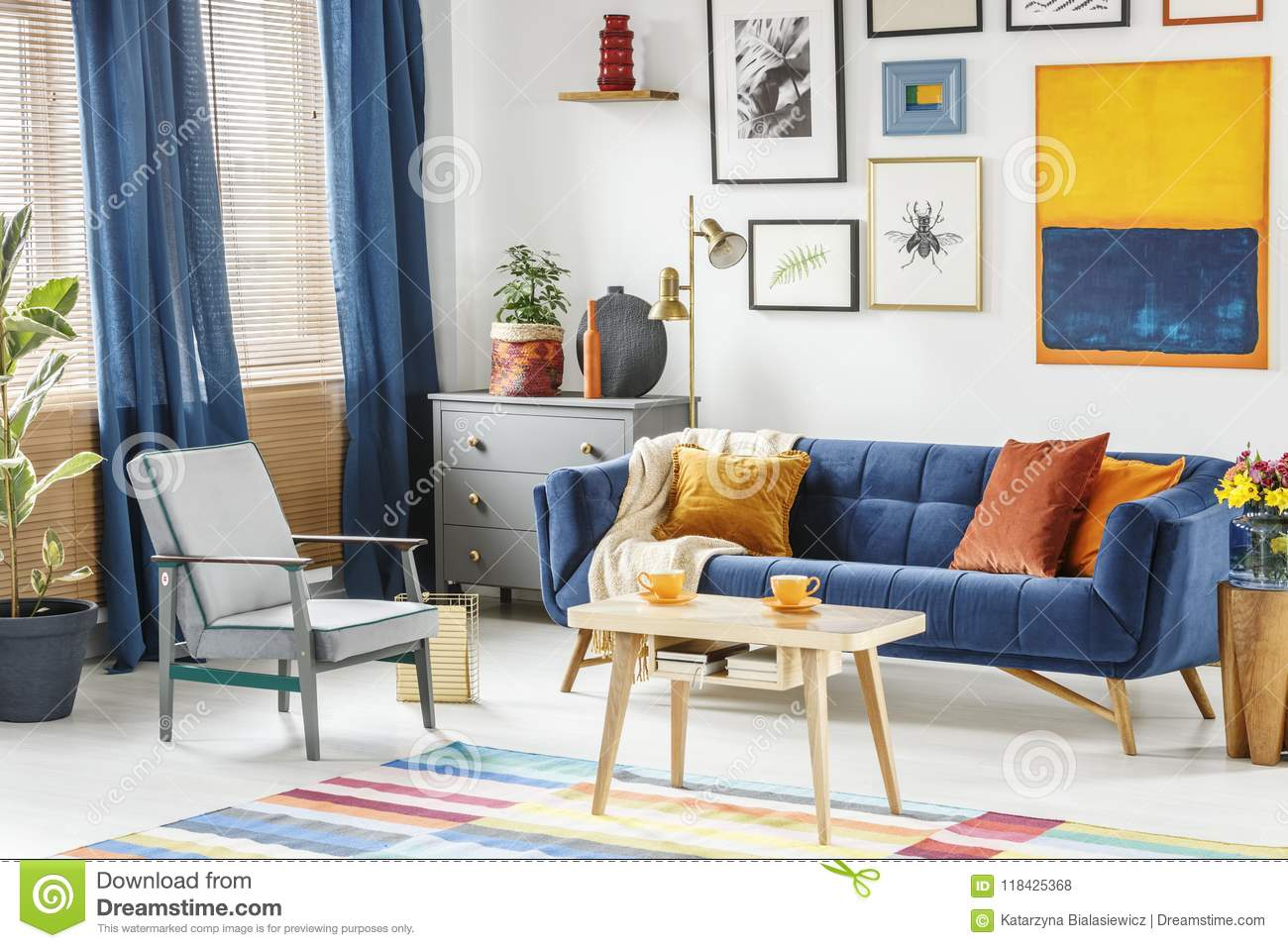 bright sofa gray accent colors and cozy living room interior with blue drapes a wi