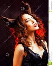 bright mysterious woman with horn