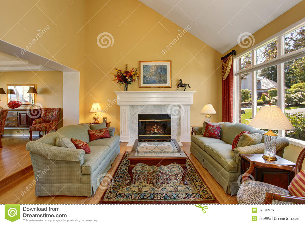 Brilliant Living Room With Green Sofas And Yellow Walls Stock Photo Image Of House Lamp
