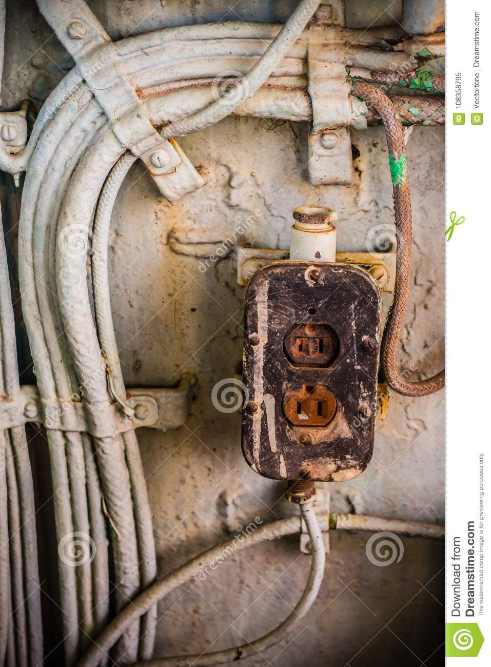 hight resolution of very old power socket with metal tube and electric wire in the abandoned industrial place