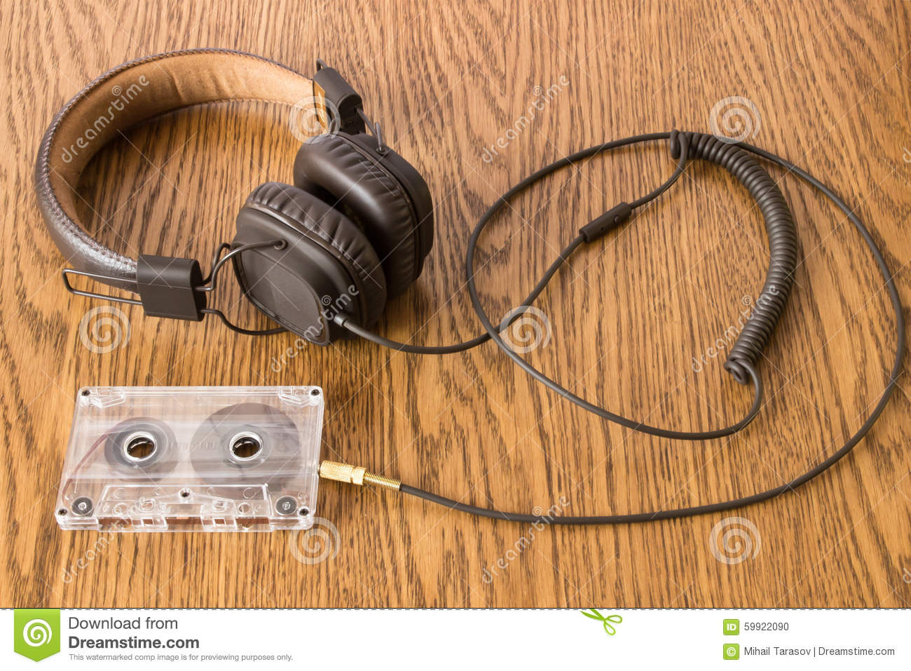 hight resolution of brown headphones with long rubber cable connected