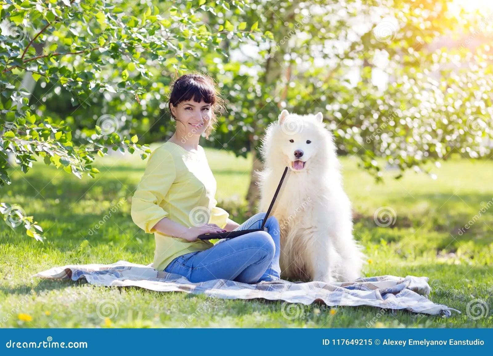Girl Freelancer With A Big White Dog