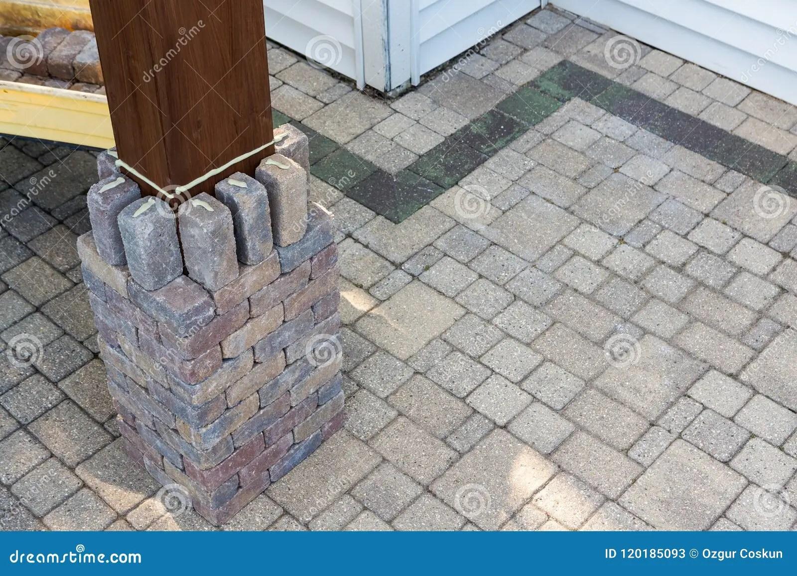 https www dreamstime com building brick pillar around timber gazebo leg building brick pillar around timber gazebo leg gluing grey bricks image120185093