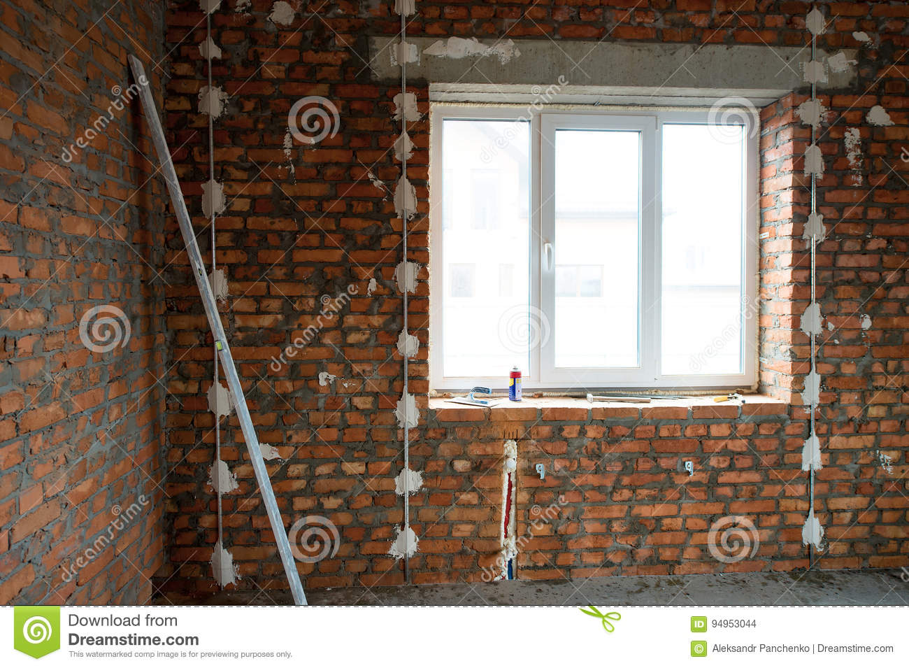hight resolution of performed work on electrical wiring and installation of windows prepared the surface of brick walls to gypsum plaster