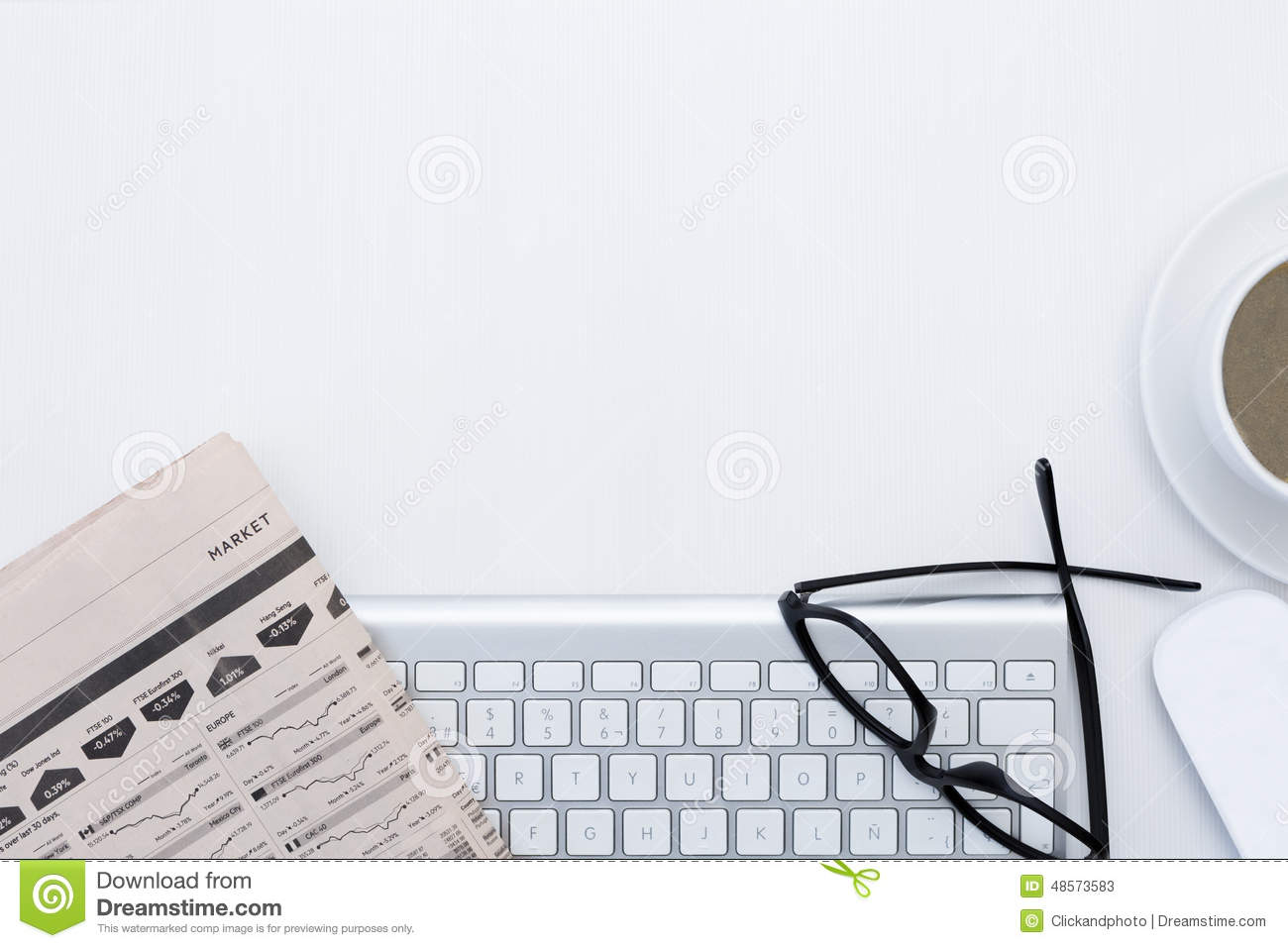Business Desk And A Wireless Silvery Keyboard Stock Photo