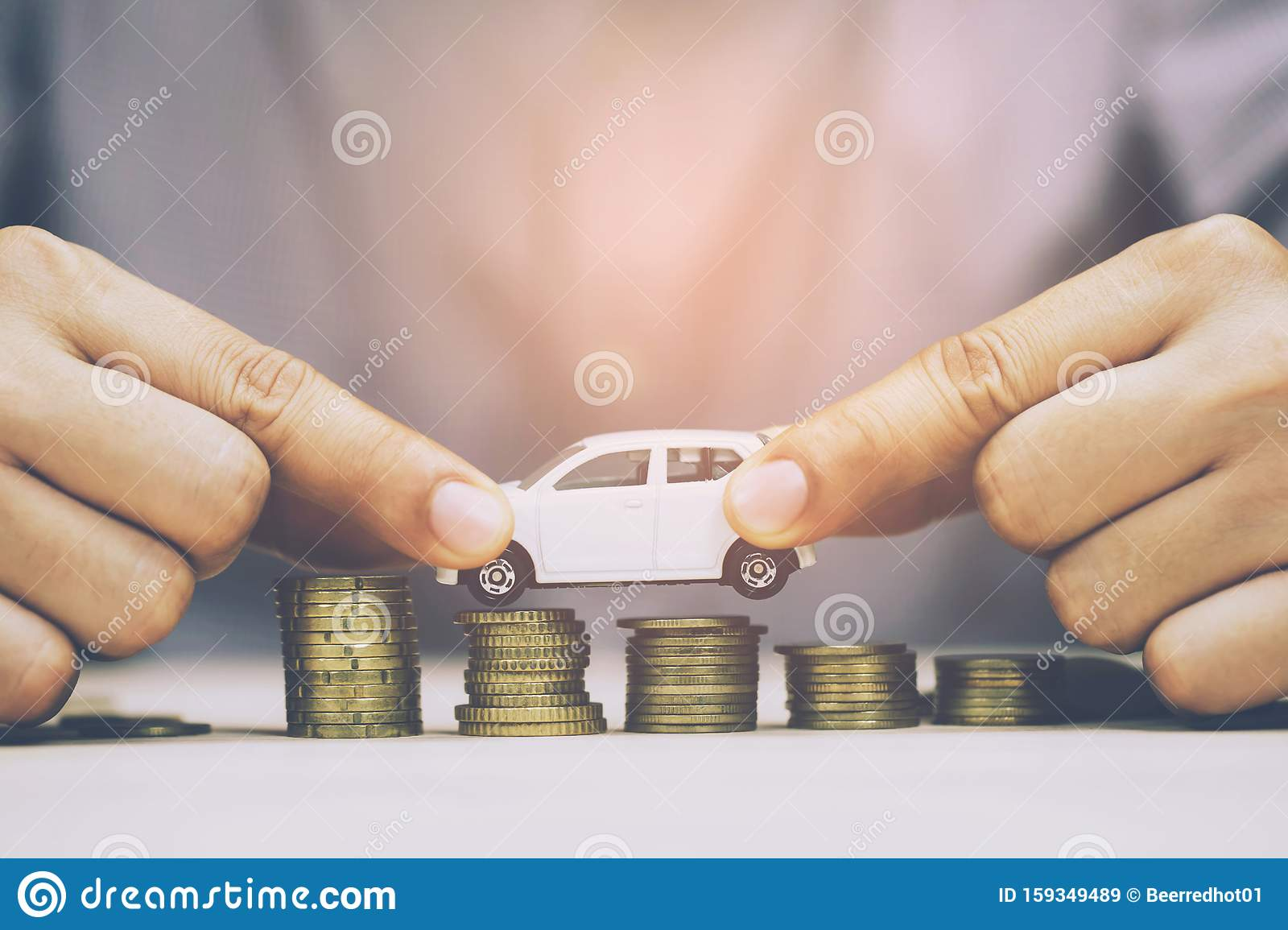 Business Man And Close Up Hand Holding Model Of Toy Car