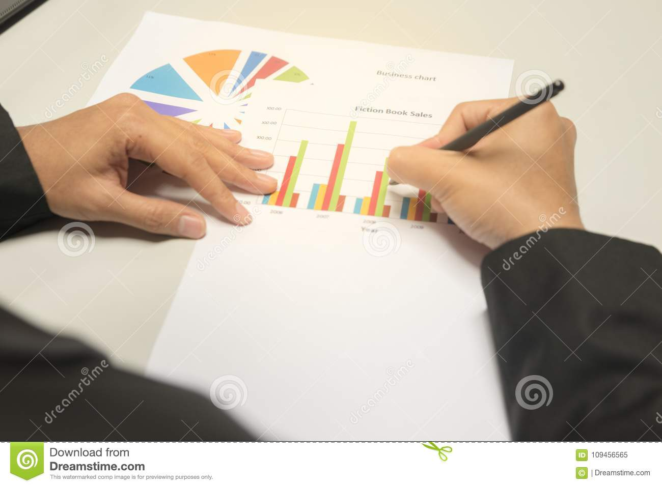 hight resolution of business man looking and writing at business charts graphs and documents background for analyzing the