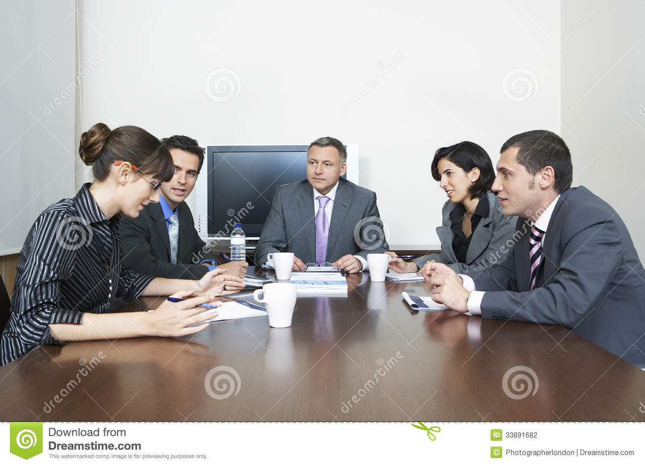 Business People Having Discussion In Conference Room Stock