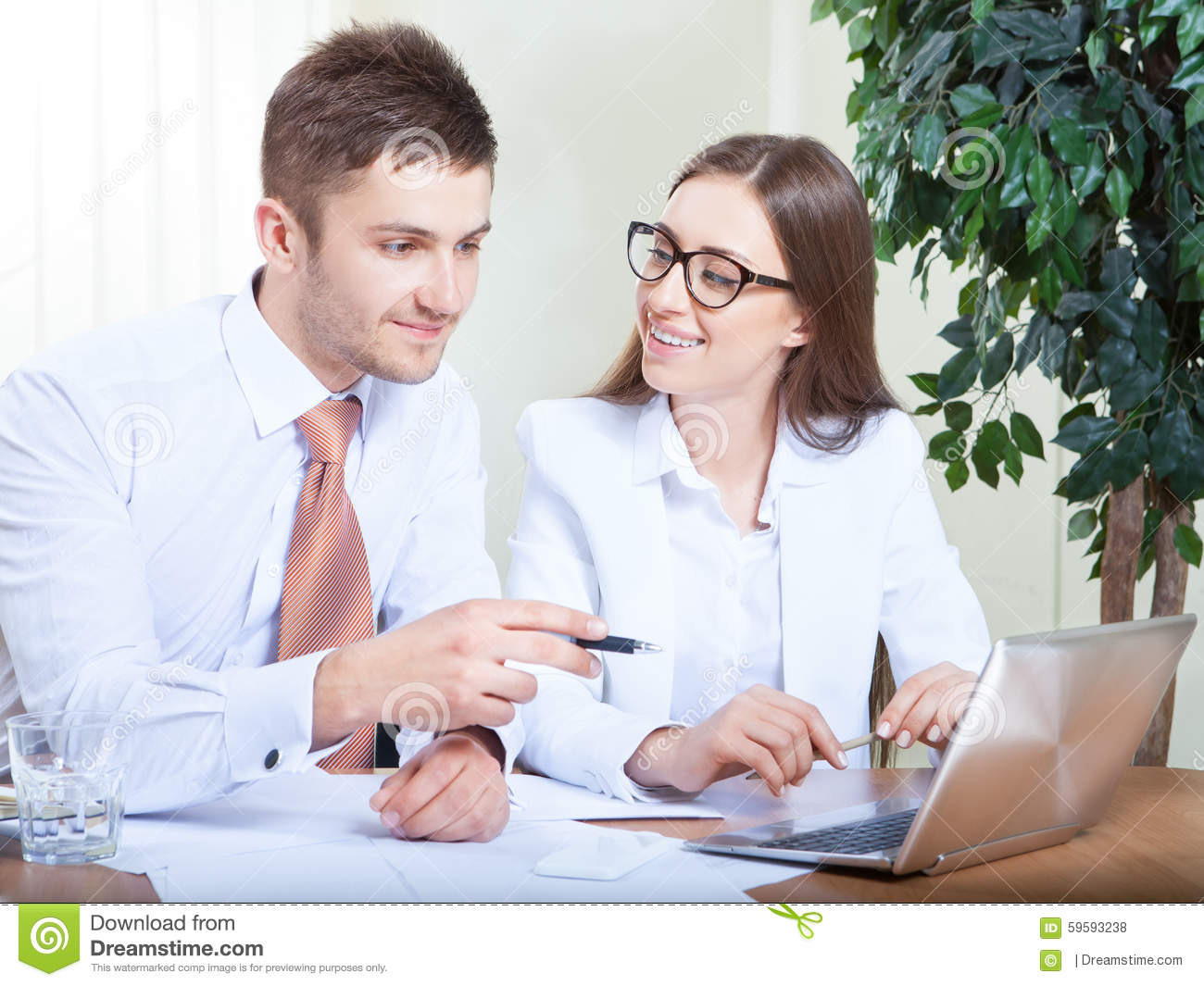 hight resolution of business people working together in office at desk stock