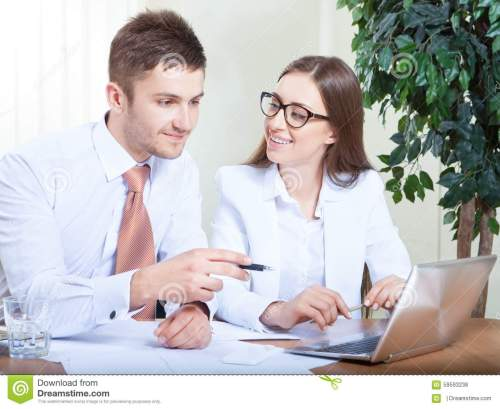 small resolution of business people working together in office at desk stock