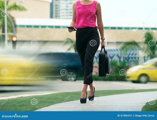 Briefcase Businesswoman Walking in Office