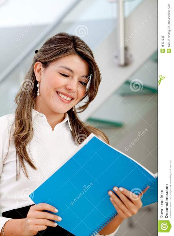 Business Woman Reading Brochure Stock