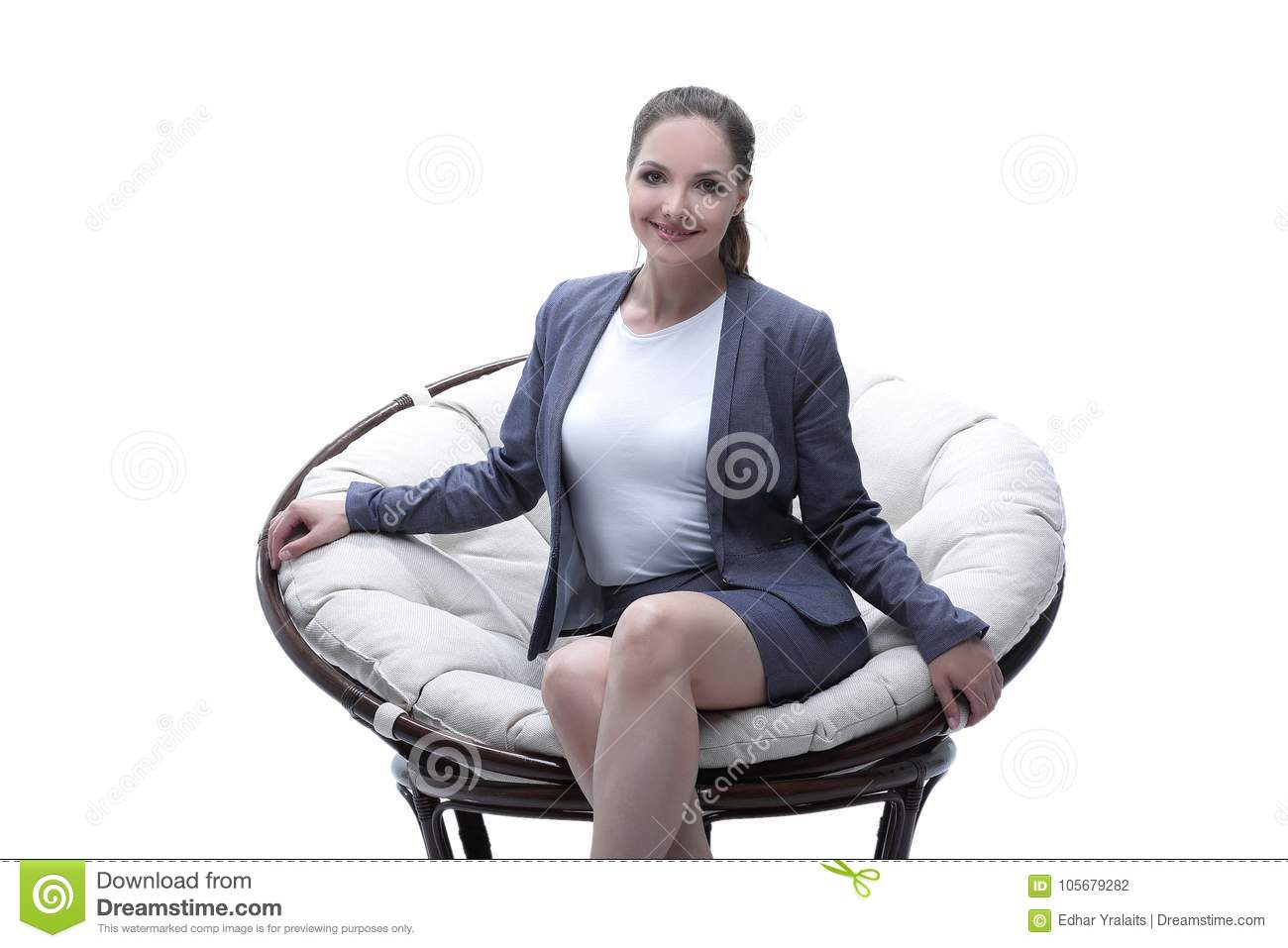 woman sitting in chair fabric twin sleeper bed business a round rattan stock photo