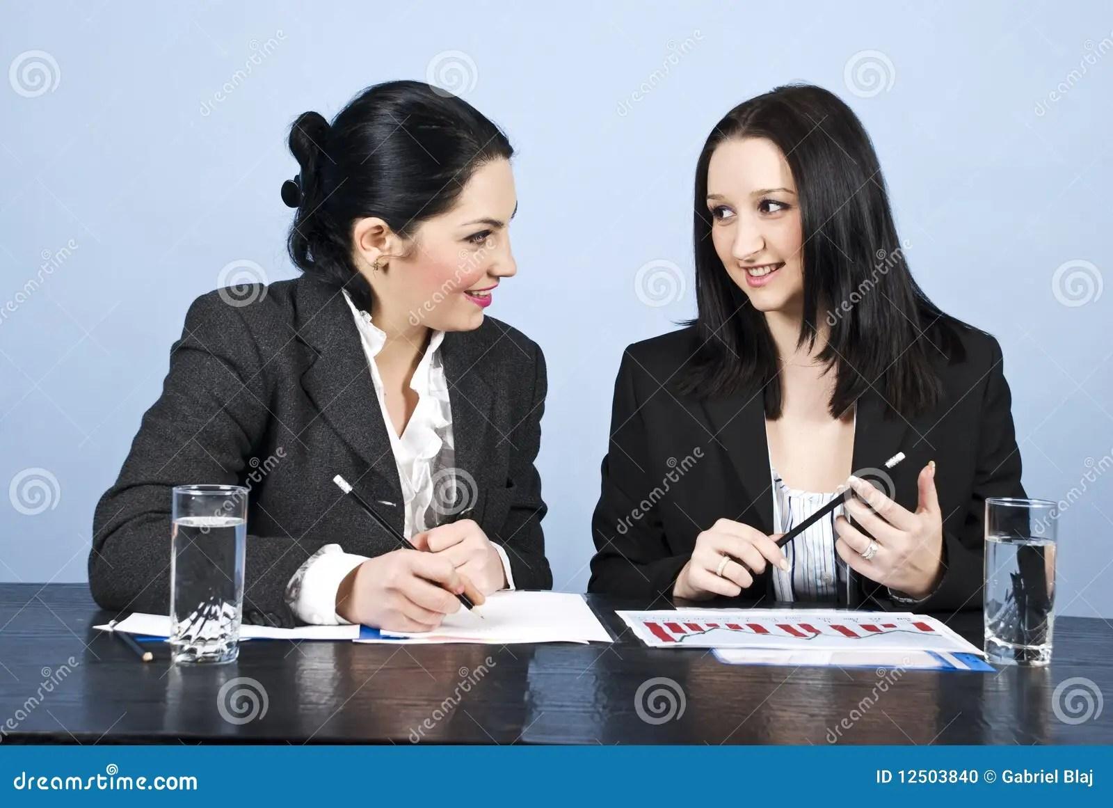 Business Women Conversation At Meeting Stock Photo