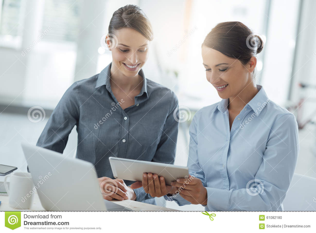 hight resolution of business women working together on a tablet stock photo