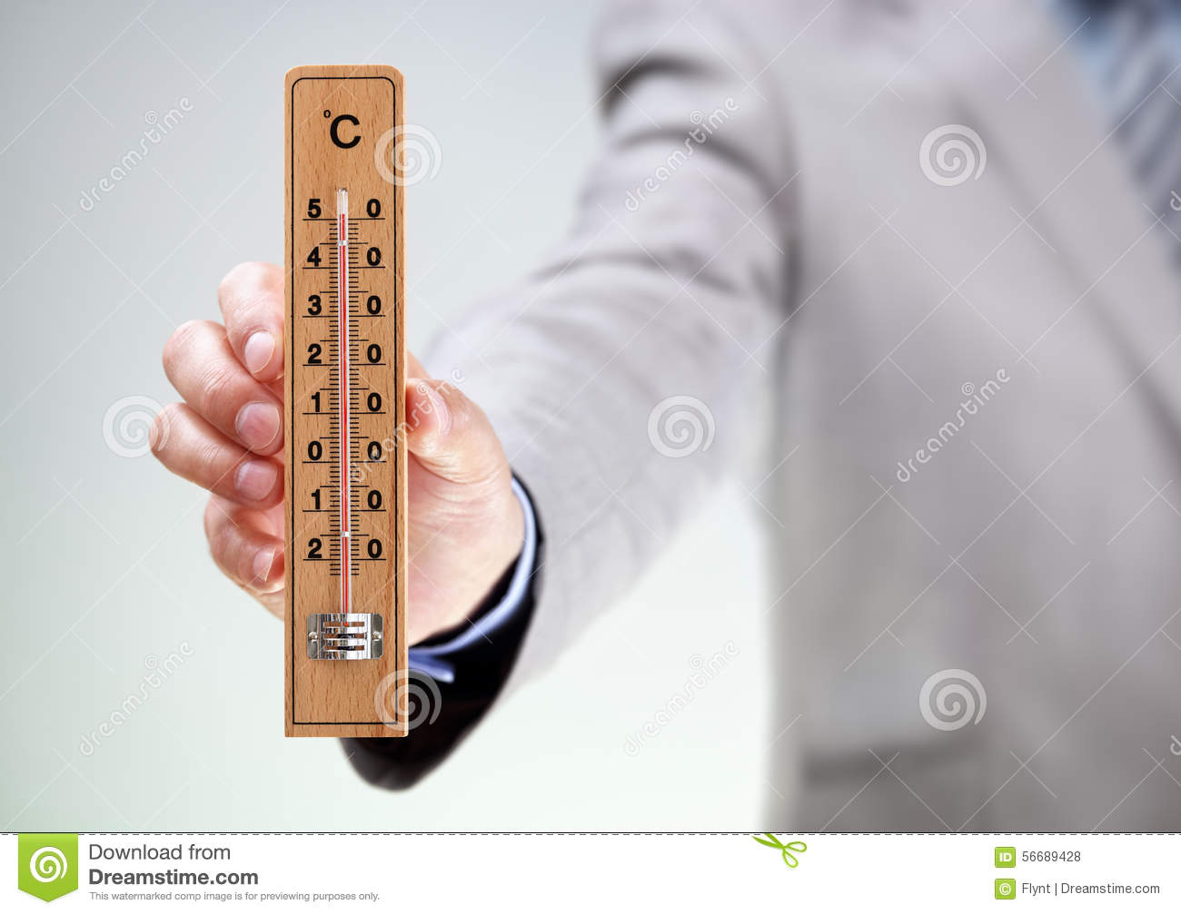 Businessman Holding Thermometer Reading High Temperature
