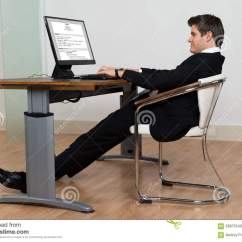 Office Chairs For Bad Backs Reviews Steel Easy Chair Businessman Leaning Back In His While Working On