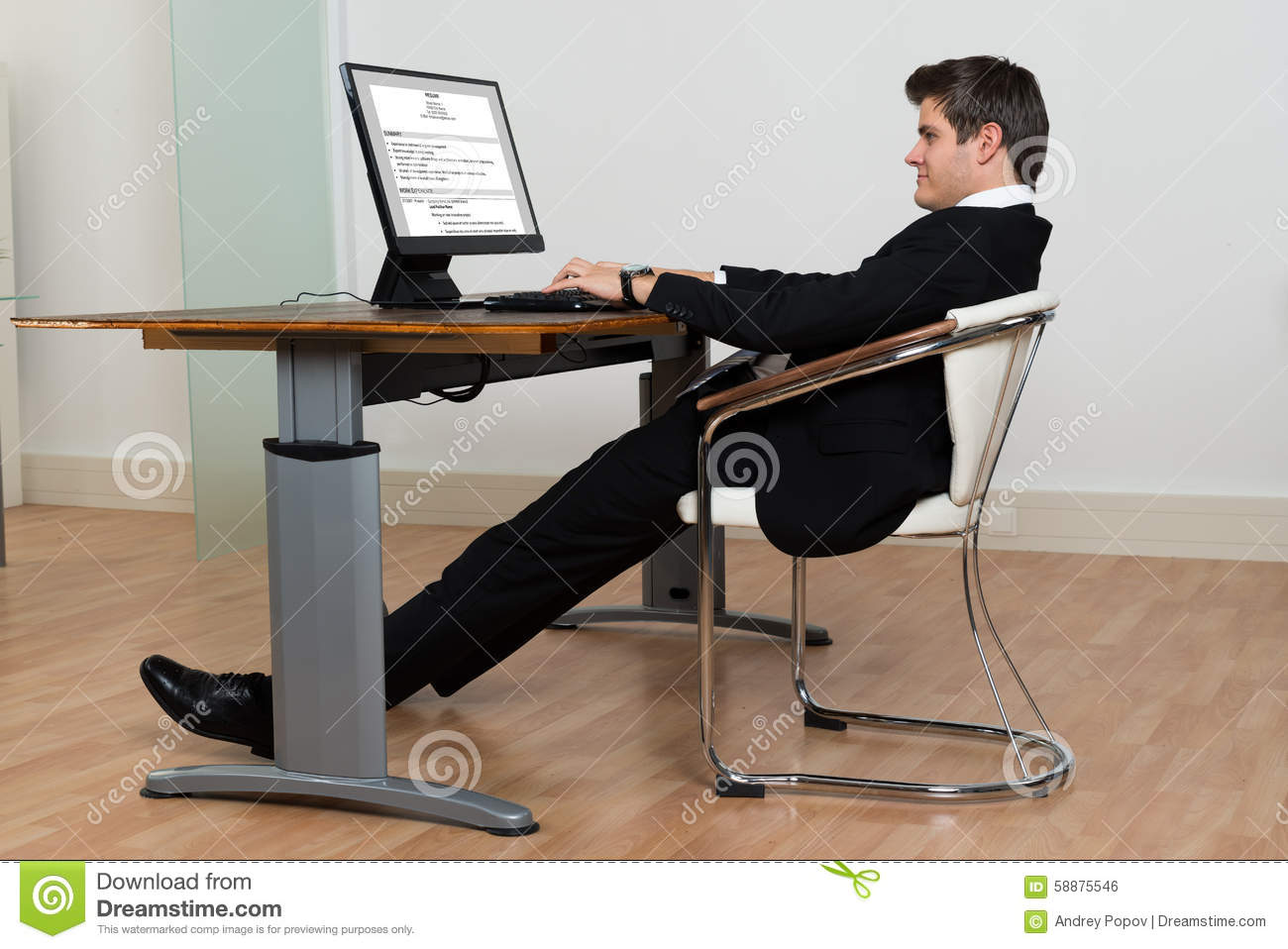 office chairs for bad backs reviews ikea spinning chair businessman leaning back in his while working on